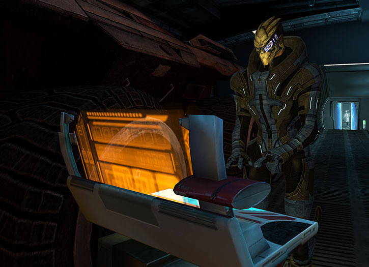 Garrus maintaining the Mako in the Normandy's bay