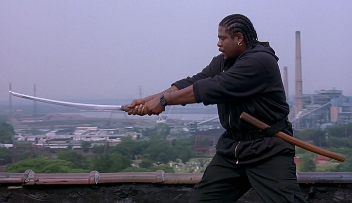 Ghost Dog (Forest Whitaker) practices his swordsmanship in a rooftop