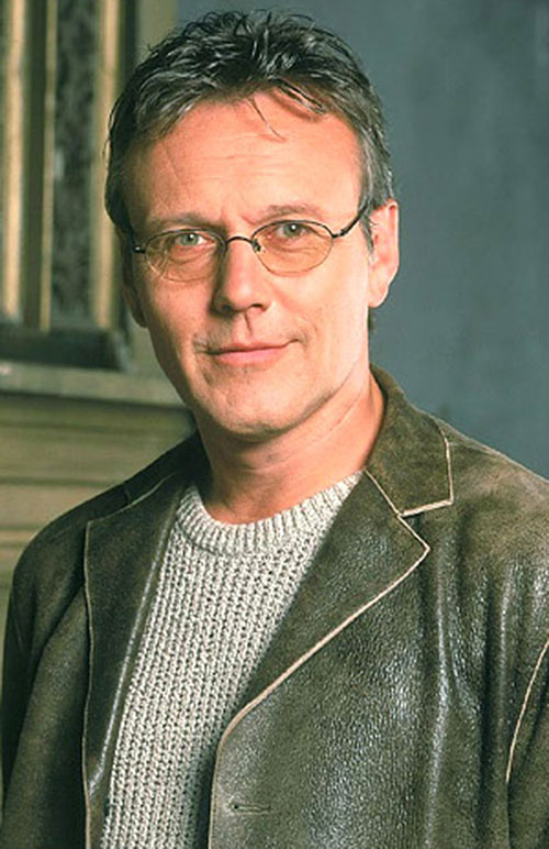 Giles (Anthony Head in Buffy) in a leather jacket and knit sweater