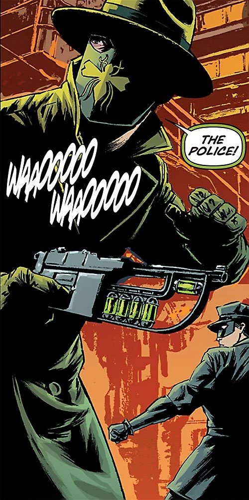 Green Hornet (Matt Wagner Dynamite Comics) with his gun out, hearing police sirens