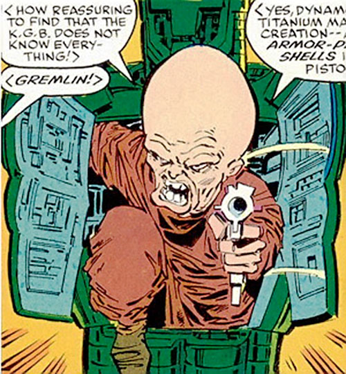Gremlin (Marvel Comics) emerging from his armor with a pistol