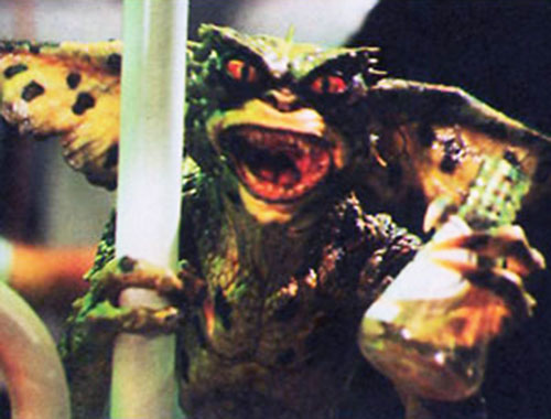 Gremlin (movies) with a beaker