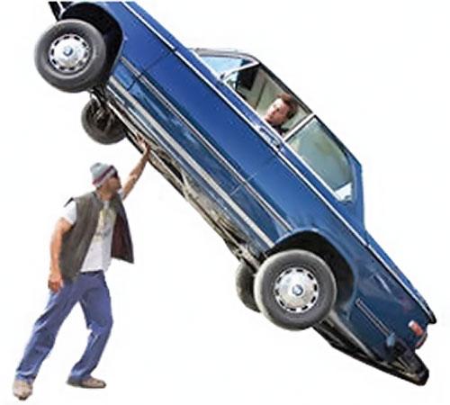 Hancock (Will Smith) lifting a car
