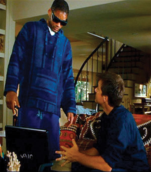 Hancock (Will Smith) with a blue sweater