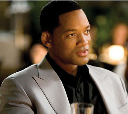 Hancock (Will Smith) in an off-white suit
