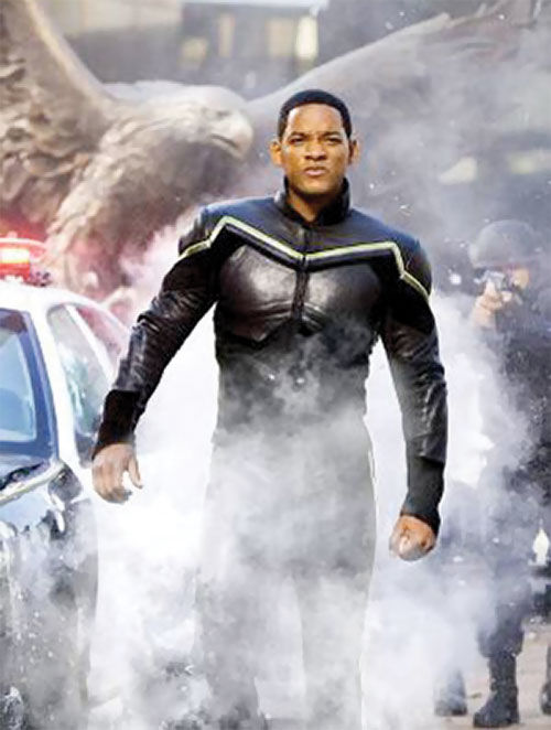 Hancock (Will Smith) in costume in the middle of smoke