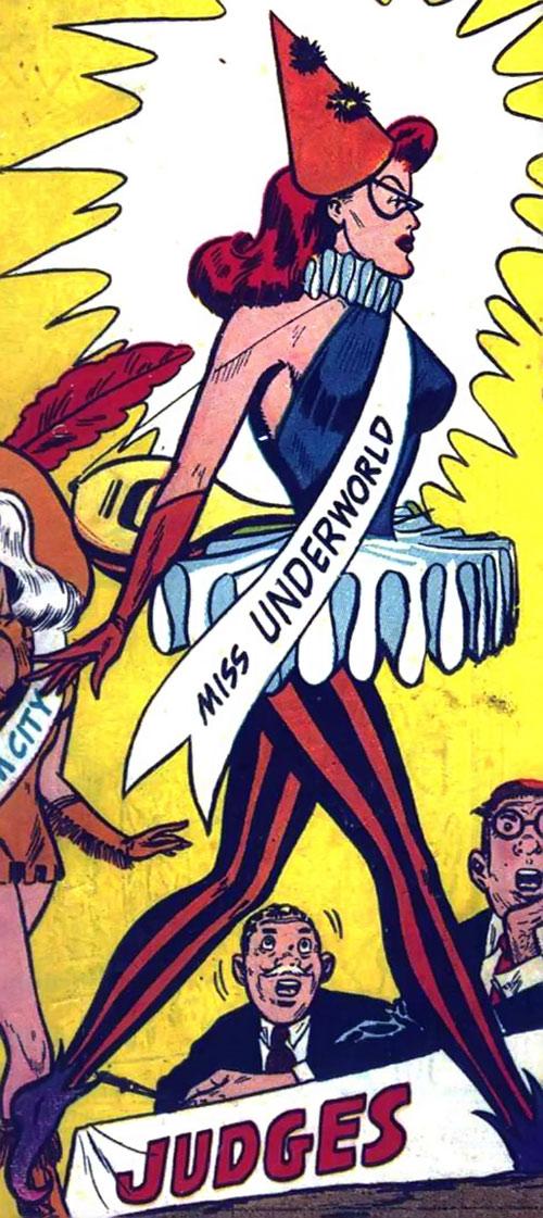 Harlequin (Molly Maynne) as Miss Underworld