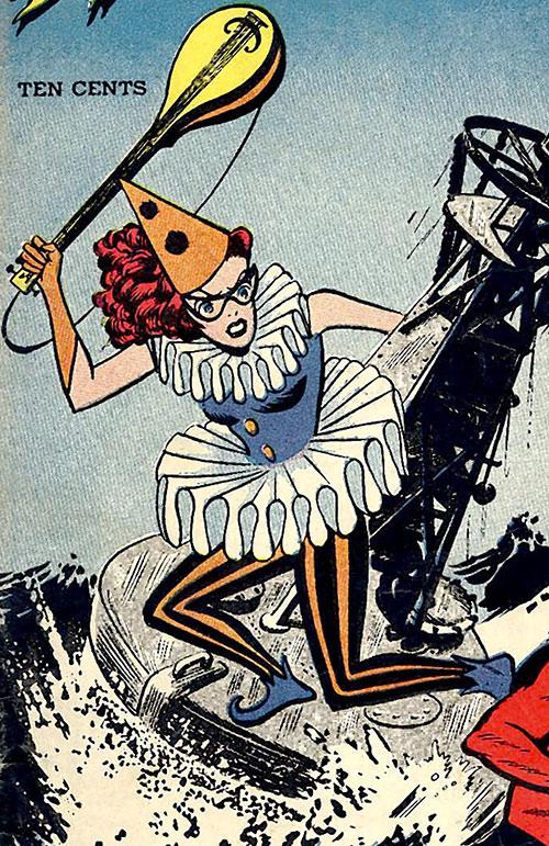 Harlequin (Molly Maynne) brandishes her mandolin