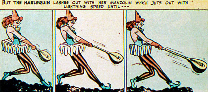 Harlequin (Molly Maynne) swings her telescoping mandolin