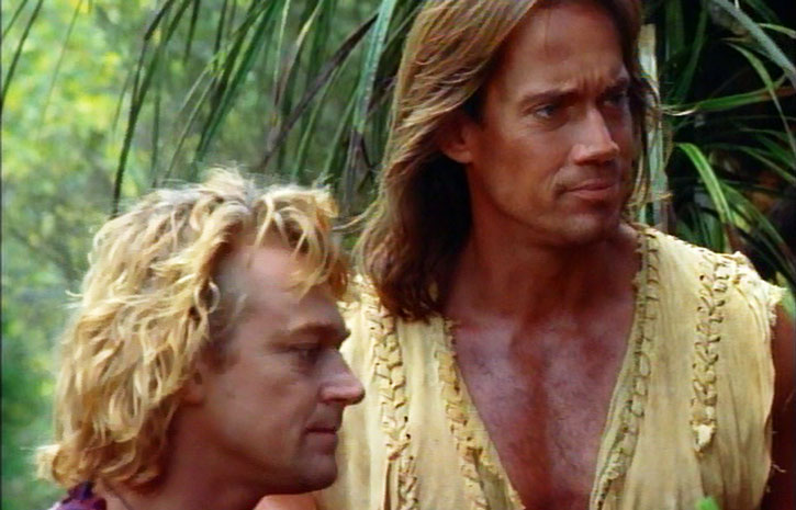 Hercules (Kevin Sorbo) and Iolaus (Michael Hurst) in a forest