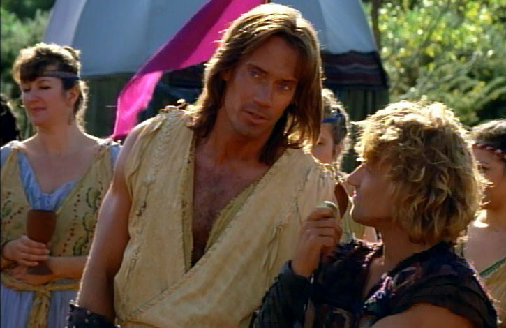 Hercules (Kevin Sorbo) discusses with Iolaus (Michael Hurst)