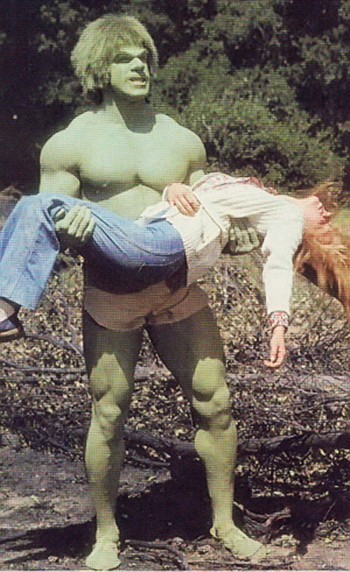 Lou Ferrigno as the Hulk, carrying a woman
