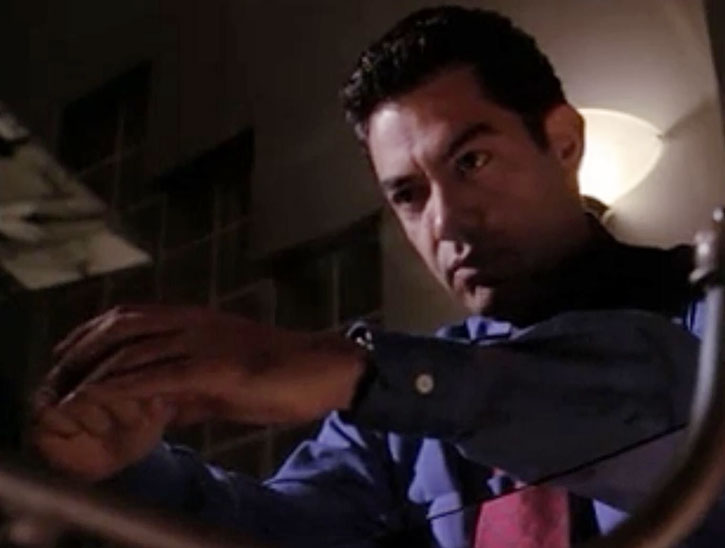 Inspector Rodriguez (Carlos Gomez) and a glass table