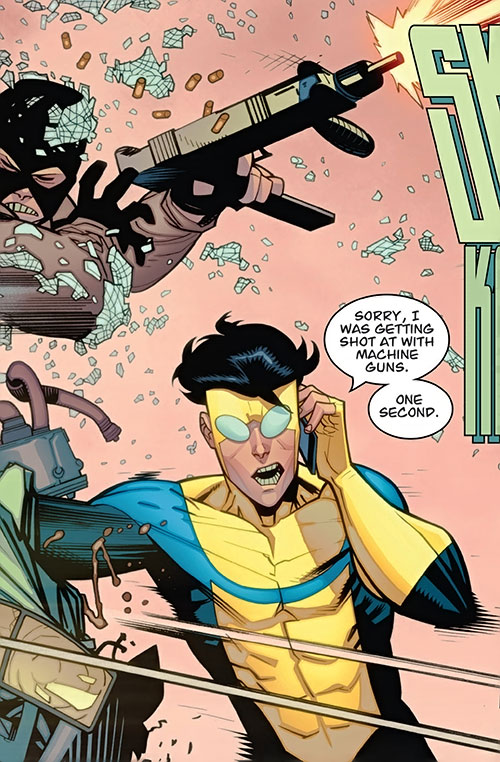 Invincible (Image Comics) smashes a guy with a submachinegun while on the phone