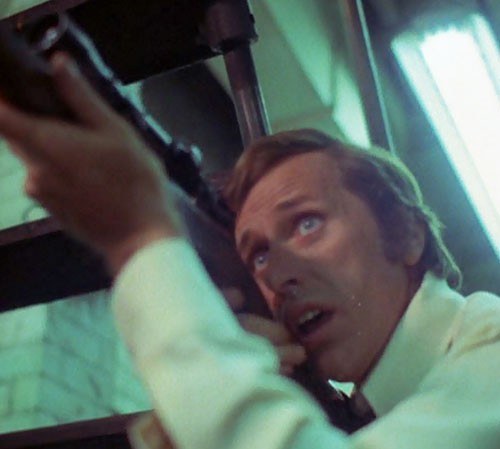 Jack McGee (Jack Colvin in The Incredible Hulk TV series) aiming a scoped rifle