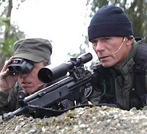 Jack O'Neill (Richard Dean Anderson in Stargate) with a scoped H&K rifle