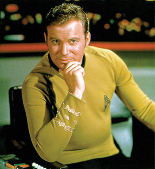 James Tiberius Kirk (William Shatner in Star Trek TOS) sitting