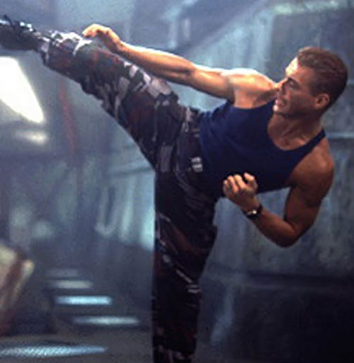 Jean-Claude van Damme throwing a kick as Guile from Street Fighters