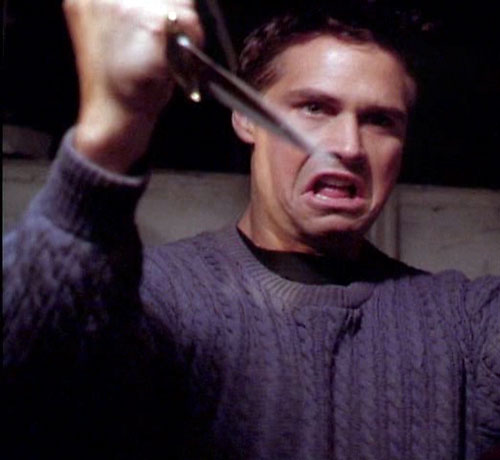 Jeremy Burns (Eric Woods in Charmed) about to stab