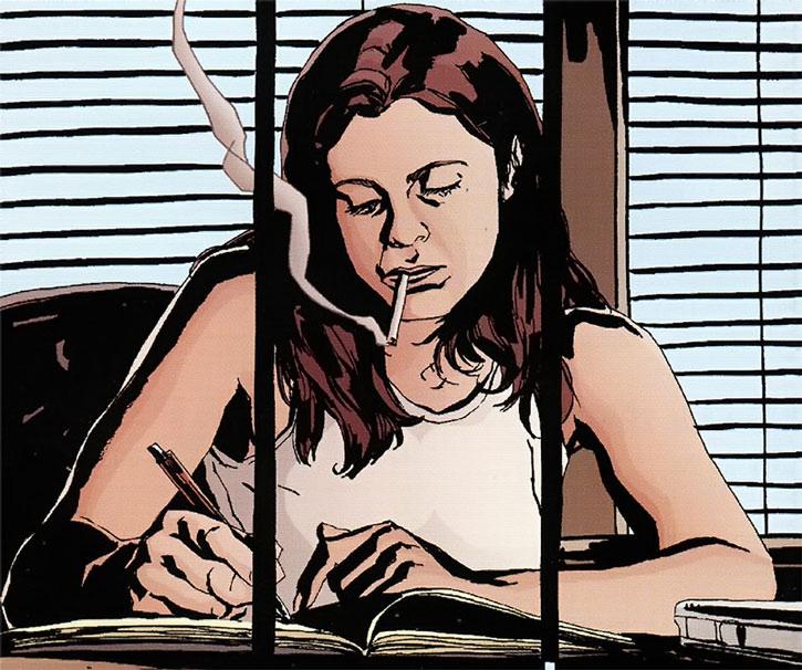 Jessica Jones working and smoking in her office