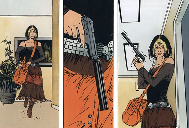 Jessie Martin readies a suppressed pistol