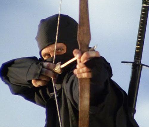 Joe Armstrong (Michael Dudikoff in American Ninja) aiming a bow