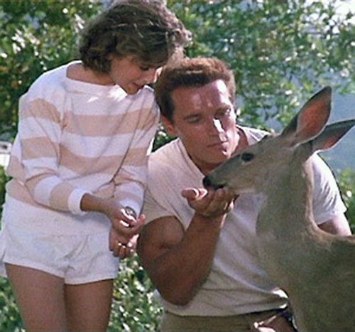 John Matrix (Arnold Schwarzenegger in Commando) with his daughter and a fawn