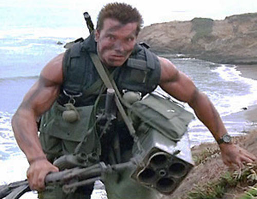 John Matrix (Arnold Schwarzenegger in Commando) carrying an arsenal