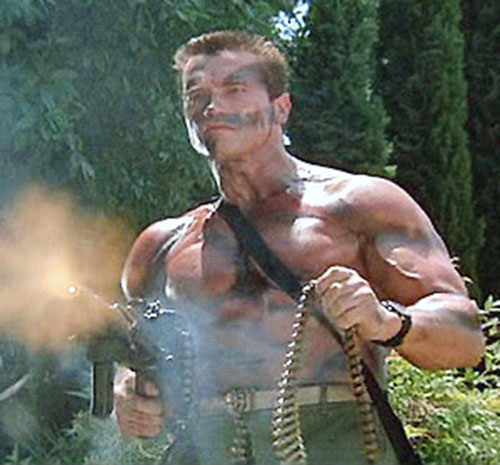 John Matrix (Arnold Schwarzenegger in Commando) firing a M60 one-handed