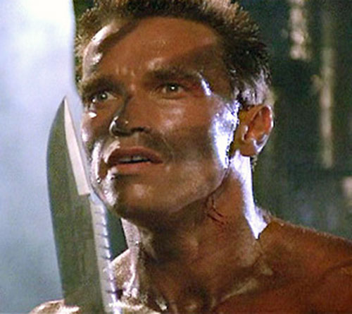 John Matrix (Arnold Schwarzenegger in Commando) face and knife closeup