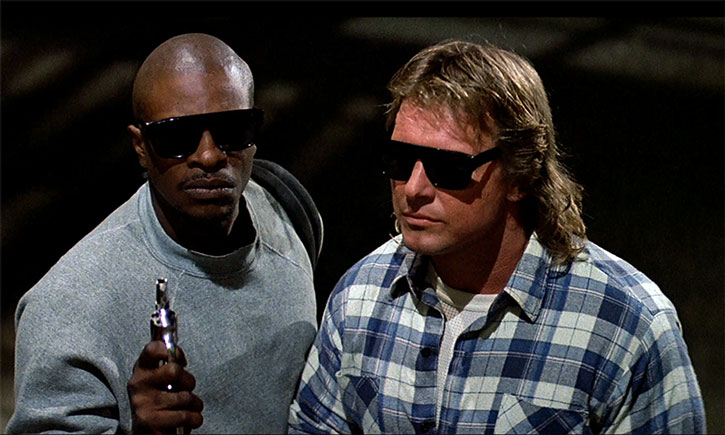 John Nada (Roddy Piper) and Frank Armitage with sunglasses on