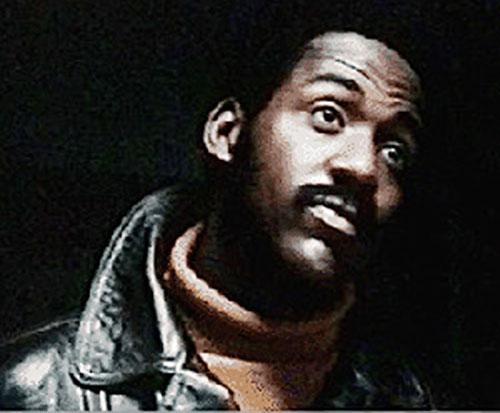 John Shaft (Richard Roundtree) over a black background