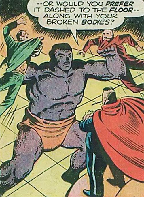 Kay-12 (Behemoth) (Werewolf by Night enemy) (Marvel Comics) manhandling 2 guys