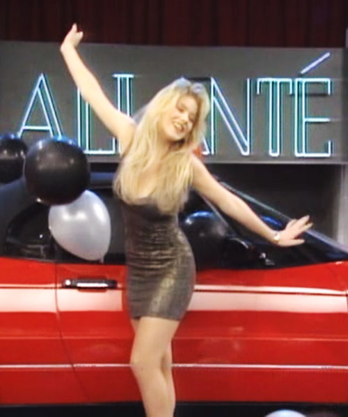 Kelly Bundy (Christina Applegate in Married With Children) black leather minidress and red car