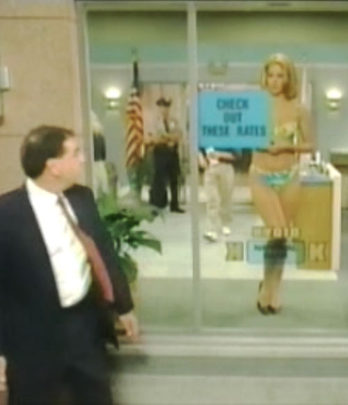 Kelly Bundy (Christina Applegate in Married With Children) in lingerie in a bank