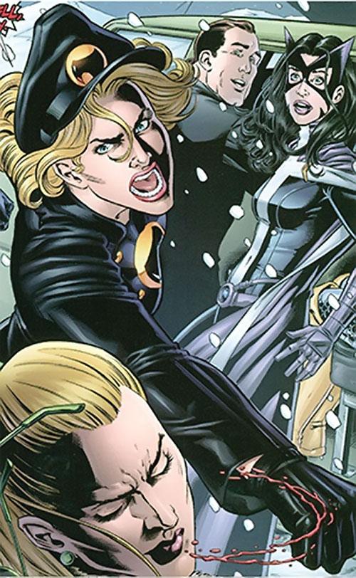 Lady Blackhawk of the Birds of Prey (DC Comics) punching Spy-Smasher