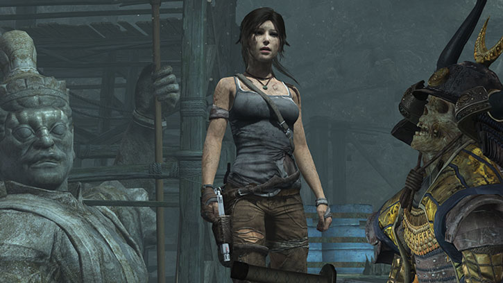 Lara Croft inspects a dead, mummified samurai