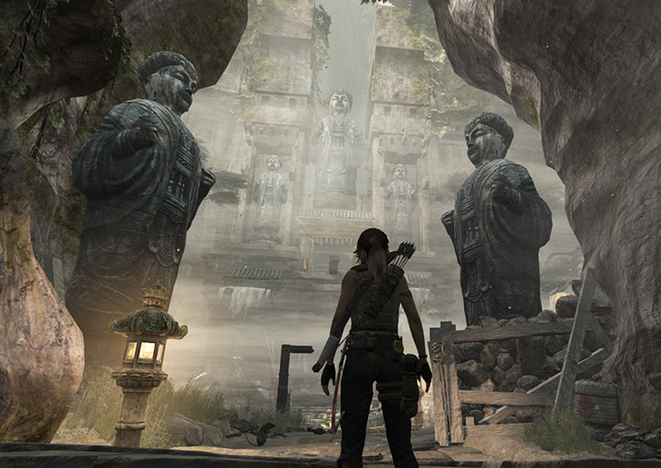 Lara Croft finds a ruin with large statues