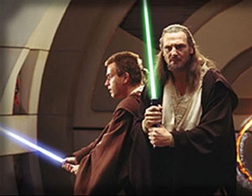 Qui-Gon Jinn and Obi Wan Kenobi with lightsabres