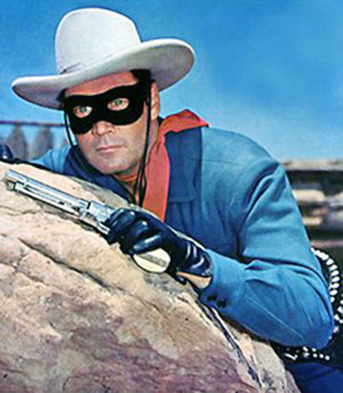 The Lone Ranger (Clayton Moore) behind a boulder