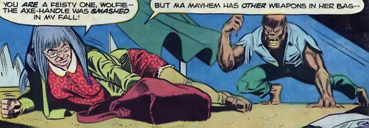 Ma Mayhem grabs a weapon in her handbag