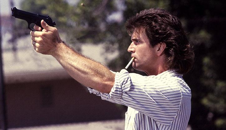 Martin Riggs (Mel Gibson) shoots his Beretta