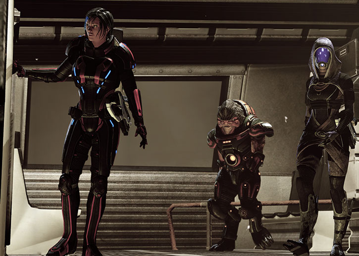 Commander Shepard, Grunt and Tali disembark from a shuttle
