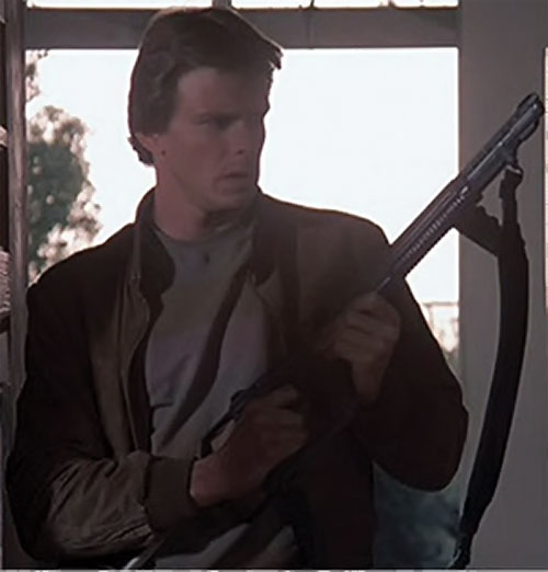 Mike Donovan (Marc Singer in V) with a shotgun