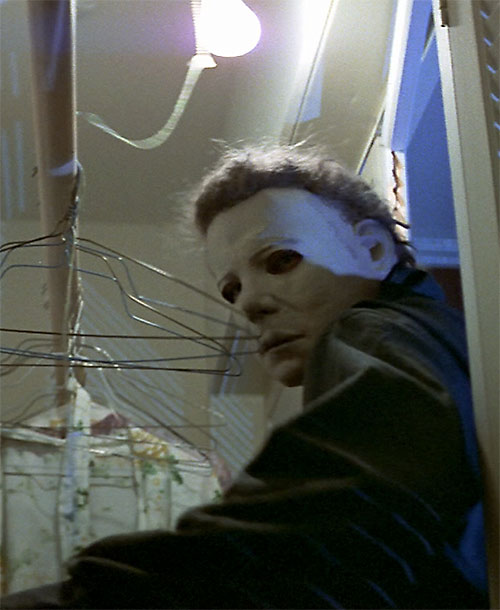 Michael Myers the Halloween Killer investigating a closet
