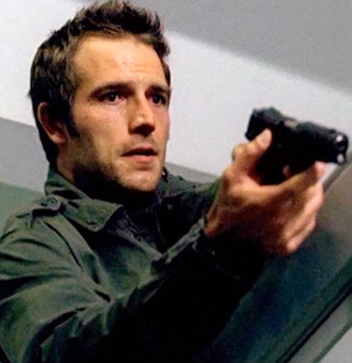 Michael Vaughn (Michael Vartan in Alias) pointing a pistol