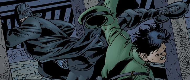 The Midnighter kicks a man in uniform