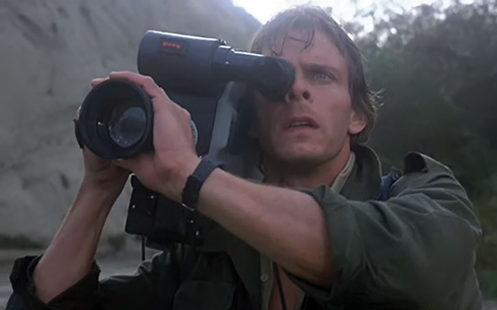 Mike Donovan (Marc Singer) operating a video camera