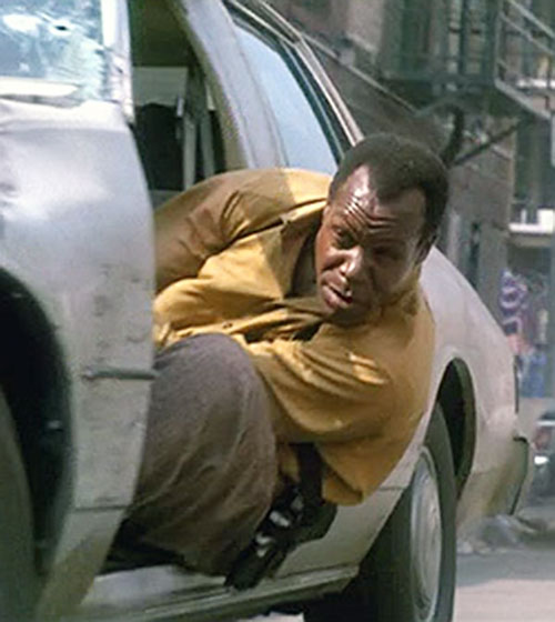 Mike Harrivan (Danny Glover in Predator II) leaning in from a car side