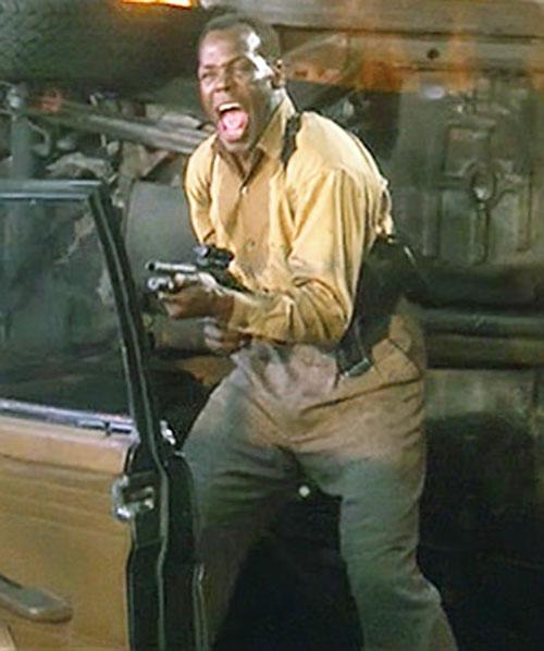 Mike Harrivan (Danny Glover in Predator II) firing a riot gun